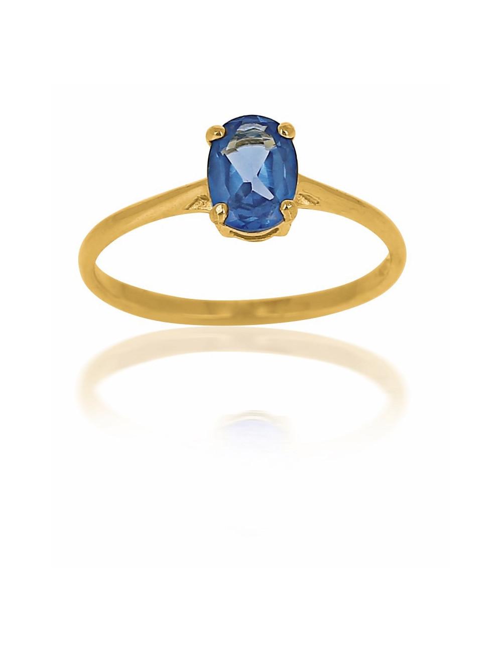 bague femme en or jaune 18 carats avec pierre bleue. Black Bedroom Furniture Sets. Home Design Ideas